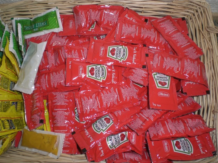 7. On your next trip, bring along a handful of condiment packets. Not only does it save money, but it will save you loads of space instead of bringing entire containers of things!