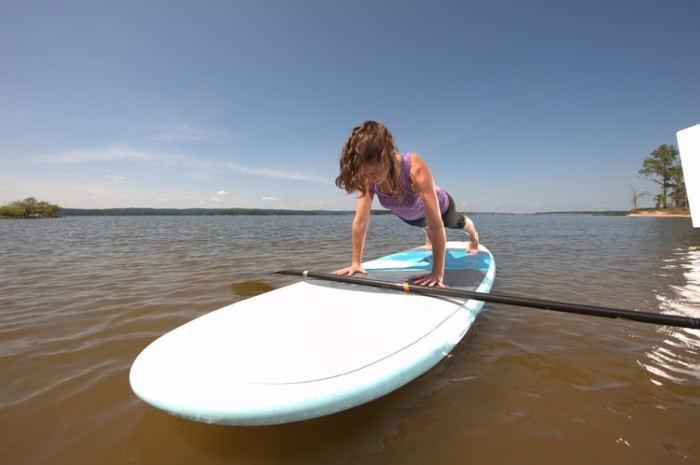 5. Find the perfect balance with paddleboard yoga.