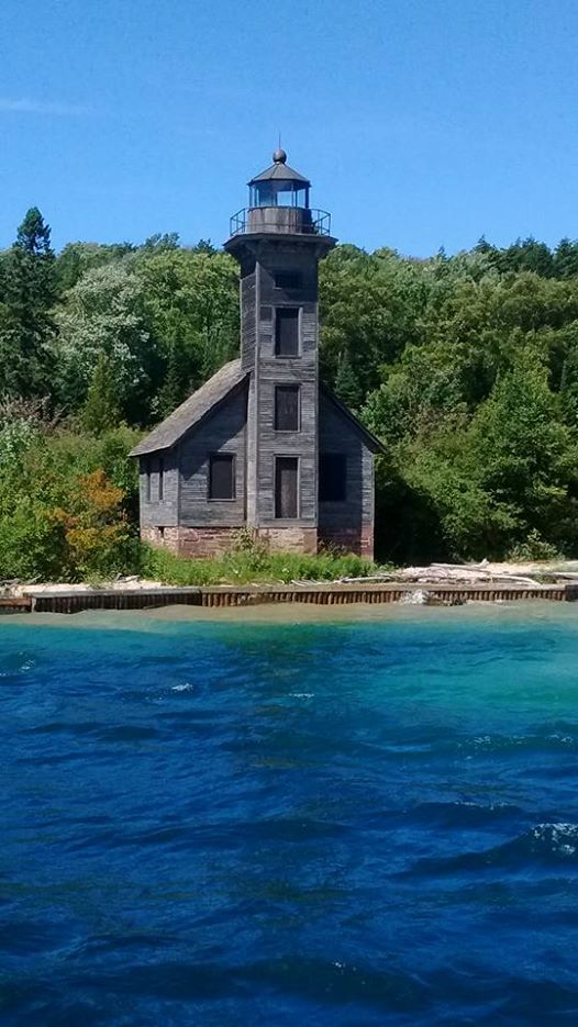 9) Amazingly, this old lighthouse at Pictured Rock National Lakeshore on Lake Superior still stands strong, as captured by Georgi McWhorter.