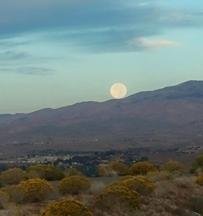 7. The full moon is wandering down the mountain. Such a NEAT photo!