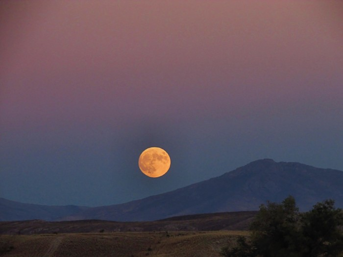 11. The October Hunter's Moon rise over the Ruby Mountains in Spring Creek, Nevada.