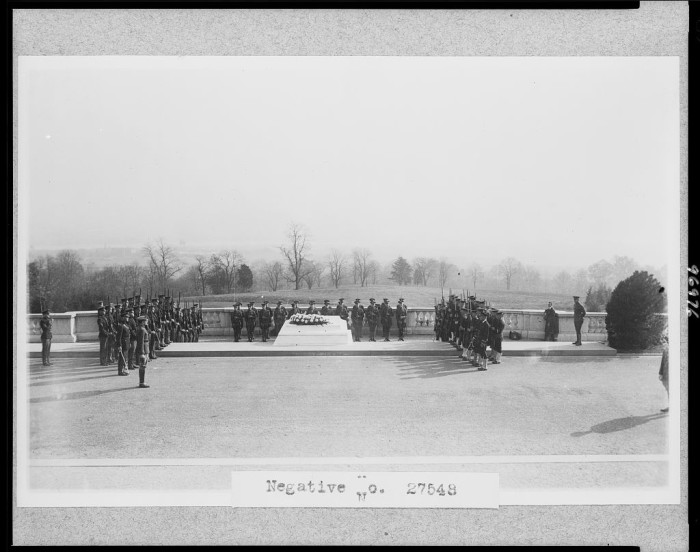 9. Soldiers gather around the Tomb of the Unknown Soldier at Arlington National Cemetery, c. 1921.