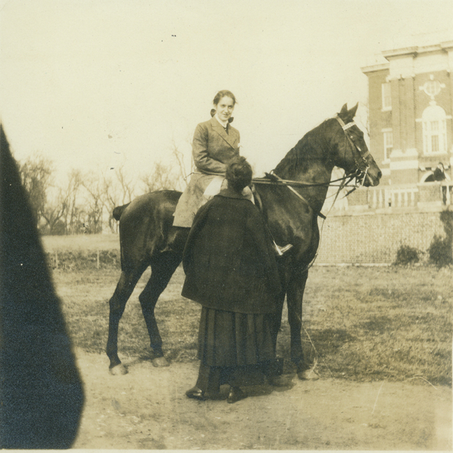 5. A Sweet Briar student sits astride a horse on the quad, 1915.