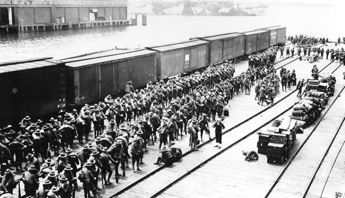 4. World War I troops waiting on the Norfolk Army Docks, 1918.