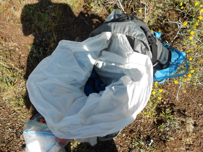 10. If you're going out hiking but not sure how the weather's going to be, line your backpack with a garbage bag for rain protection. If it doesn't end up raining, you'll at least have an extra bag for trash!