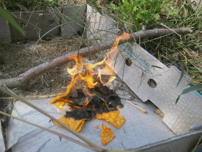 4. If you're out camping and have a bag of Doritos (or any kind of corn chips), you can use them as cheap kindling!