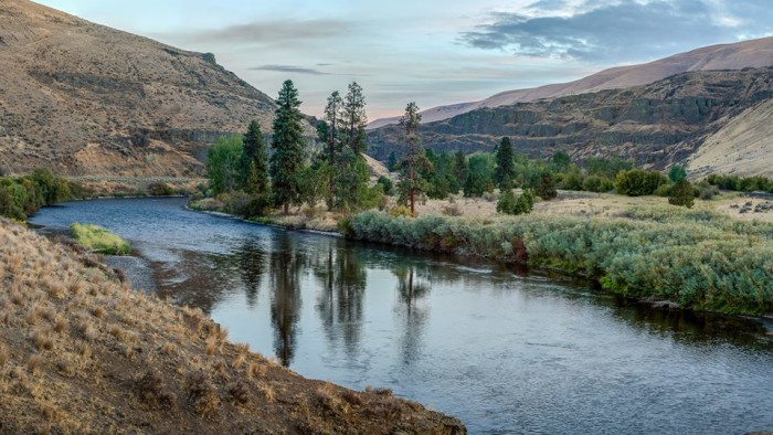 """5. This fantastic photo from Lonny Smart shows the Yakima River looking downstream from the """"Pacman Cliff"""" where people jump into the river."""