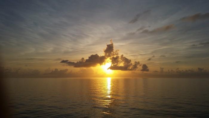 2) Beautiful sun peeking from the clouds.