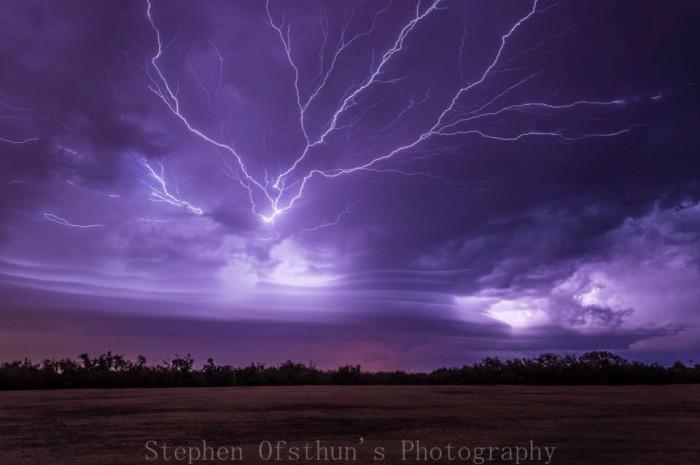 12. Lightning strikes over Griffin Memorial Park in Norman, OK.