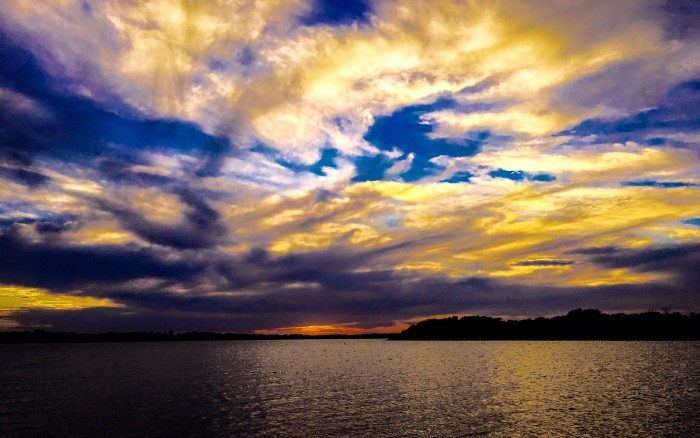 2. What a captivating view of the clouds above the lake.