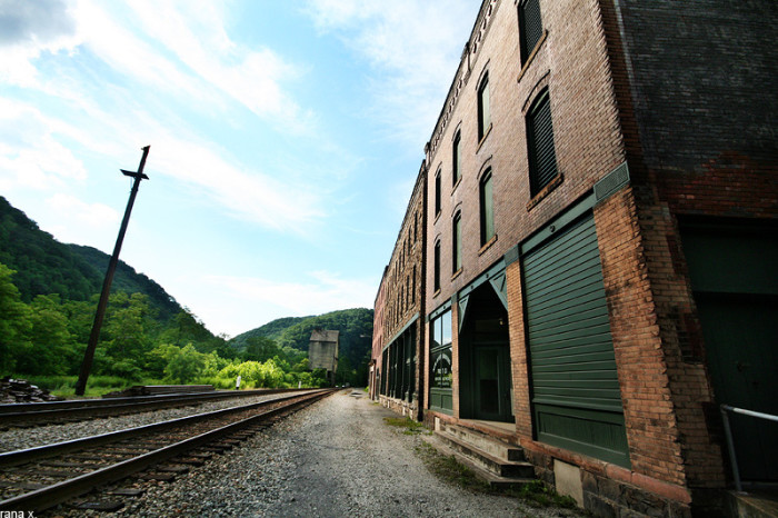 One of the town's oddest features is its lack of a road to the commercial district. The railroad tracks are separated from the town's buildings by a few scant yards of empty ground. The town was only accessible by railroad until 1921.