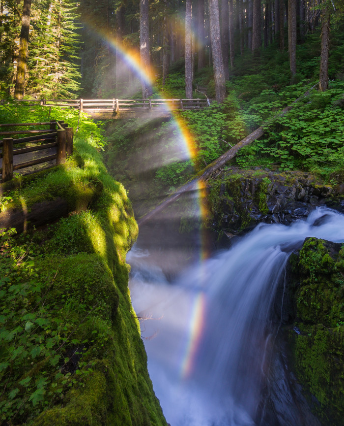 2.  This surreal photo of Sol Duc Falls was taken in the Olympic National Park! If the sun is out during certain parts of the morning, it can strike this waterfall, forming a rainbow!