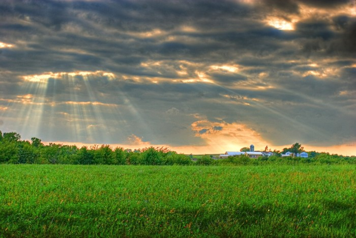 2. The sun peeks its way through the heavens over this farm in Eau Claire County.