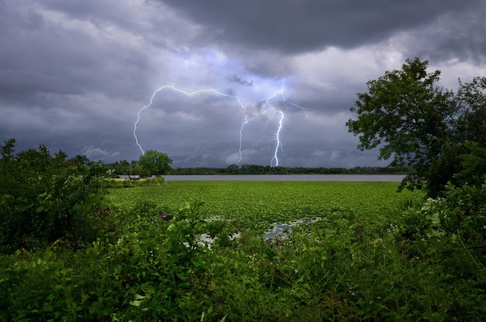 12. Lightning strikes over Madison in the background.