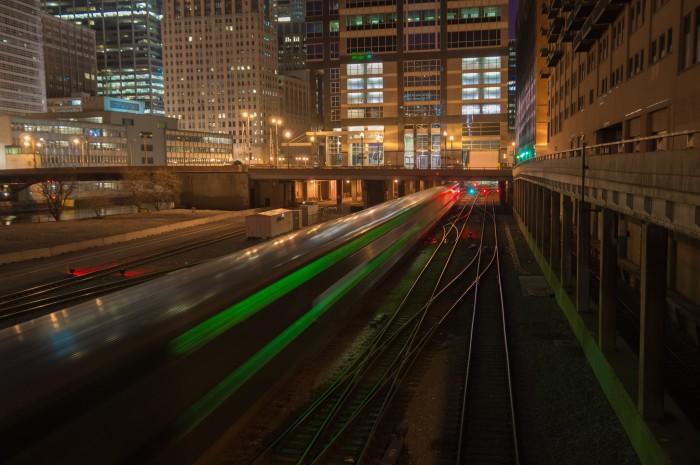 10. Trains speed through the rail yard.