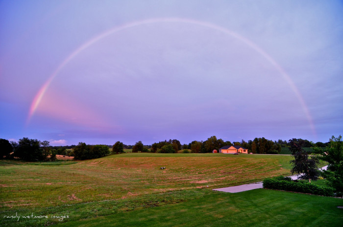 13. This magical rainbow near Marshalltown shines bright as the day turns to night.