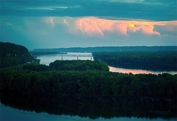 7. This amazing shot showcases a storm transpiring in the distance down the Mississippi River.