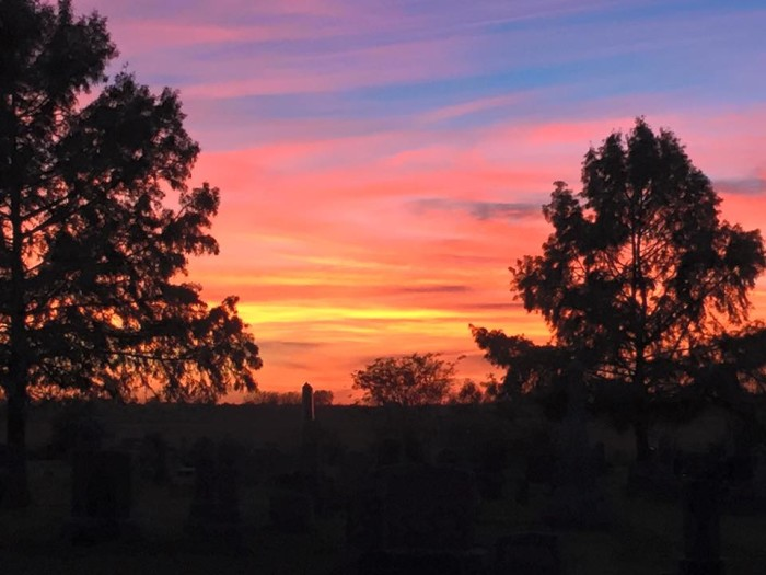 20. Living and dead enjoy this sunset over Hill Prairie Cemetery.