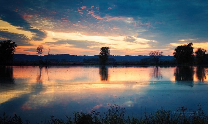 5. This is a shot of sunset over the Mississippi River from the Blanding Recreation Area.