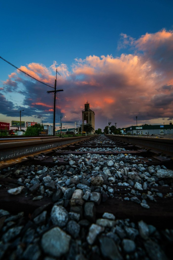 6. If you look hard enough, you can see there is a small rainbow inset in the clouds lingering above Seymor. What I really love about this piece is how this photographer was able to take a picture of the downtown area and some train tracks and make it look so spectacular.