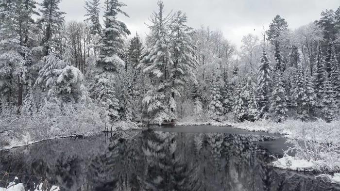 23. After this year's first snow, every lake is a reflection of blissful winter scenery.