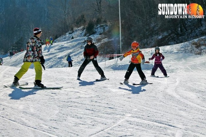 They offer 21 runs, 2 terrain parks, 4 lifts, and 475 feet of vertical for all levels of skiers and snowboarders. And don't worry, if you've never skied before, you can get some lessons from an expert before you hit the slopes!
