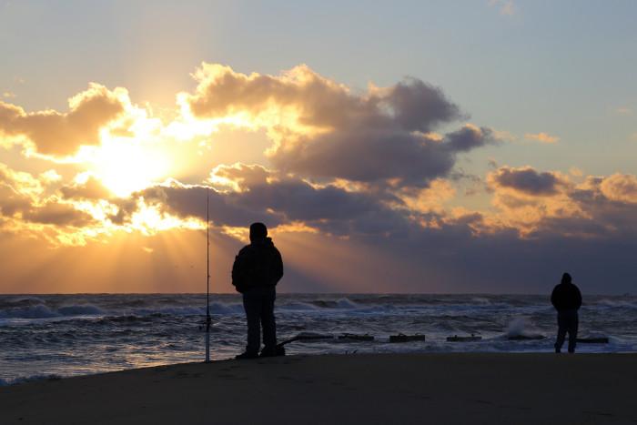 5. Fishermen awaiting the day's catch.