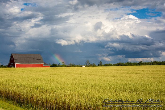 3. A lovely red barn set against a dramatic stormy sky.