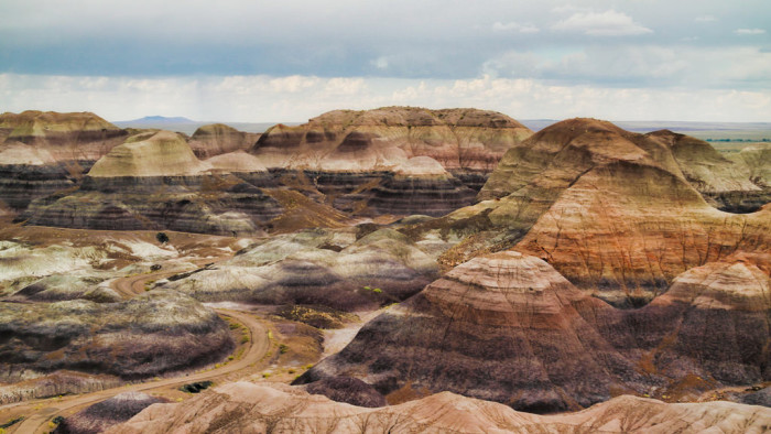 1. Let's start off with this view of the Painted Desert located within the Petrified Forest National Park, which is beautiful and unique.