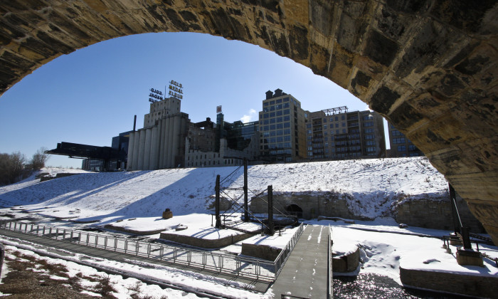 4. In Minneapolis, the snow covered Stone Arch Bridge and Mill City Ruins look spectacular against the rest of the city.
