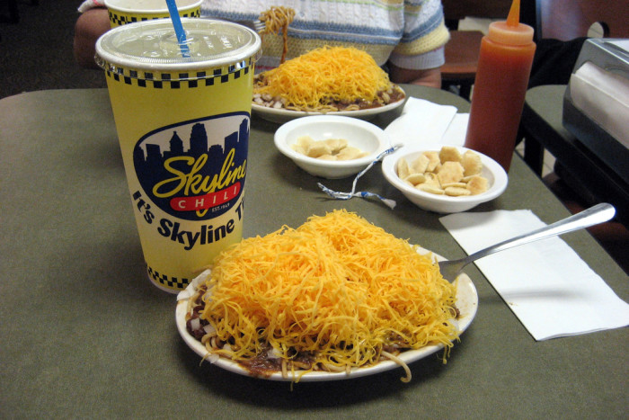5. We eat large amounts of shredded cheese and chili on top of spaghetti…
