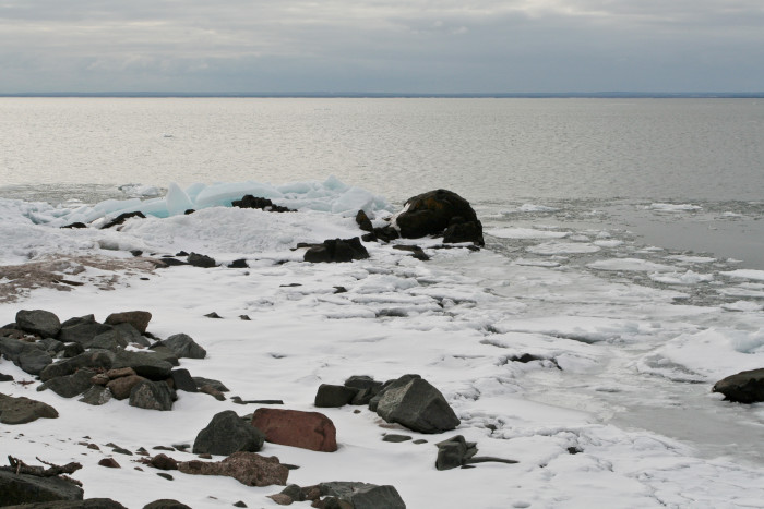 12. On the shores of Superior, the snow and ice cover the rocky beaches.