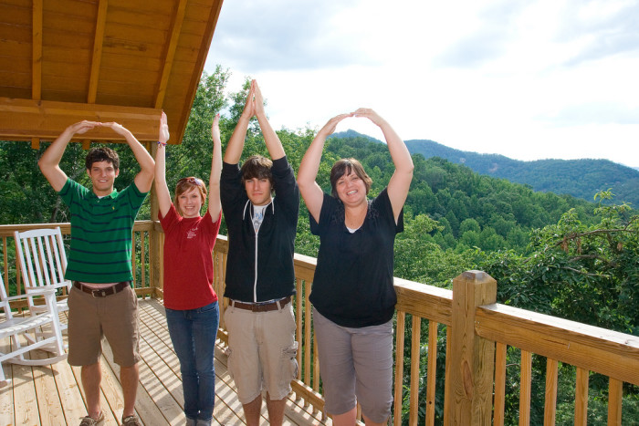 2. We spell our state's name with our arms and take a photo—no matter where we are.