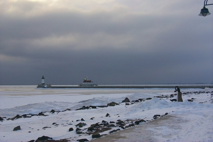 8. The Duluth lighthouse down the snowy shore looks even more spectacular in the winter.