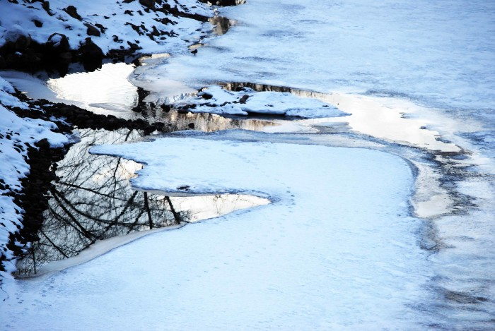 5. The reflectiveness of an icy lake, combined with the bright white snow, make for a stunning photo.