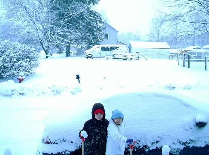 Being parent-of-the-week by turning the kids loose to play outside. With shovels. Near the car.