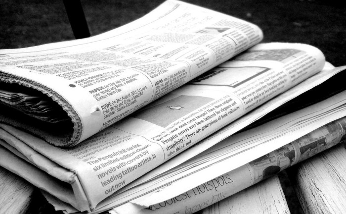 9. We waited until the following day to receive news updates through a newspaper.