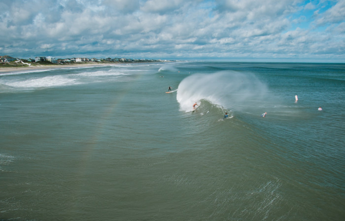 2. Surfers catching some waves off the coast of Emerald Isle.
