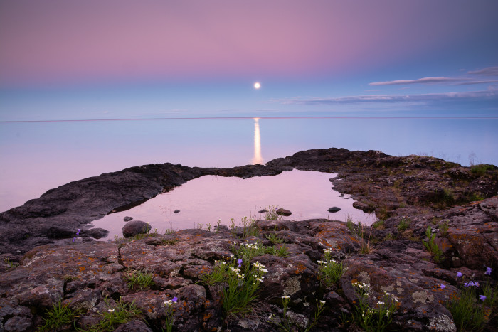 9. The moon on Superior and the reflectiveness of this water give an amazing effect to this photo.