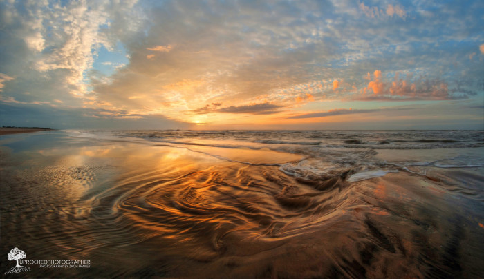 11. Swirling tide pools at high tide on Assateague Island create a beautiful surface in this gorgeously captured image.