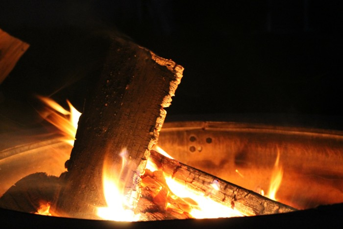 14. Sitting outside around a campfire or patio fire pit with friends is the best - until the mosquitos show up.