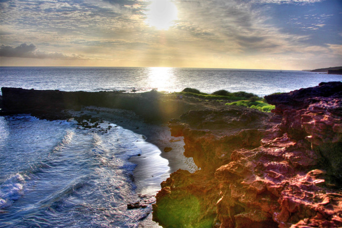 4) I feel as though I am at the edge of the world when looking at this photograph of Holopo'e Bay.