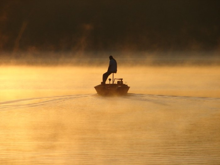 14. Talk about heading into the unknown…this photo of a fisherman was taken on Lake Cahoon in Suffolk.