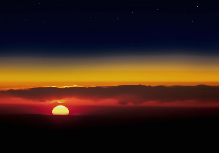 10. This sunset looks like it was captured on the edge of the world but was actually taken from an airplane over the Virginia Coast.