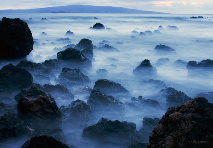 1) Waves crash against Maui's Wailea Shore creating a fog-like ethereal effect reminiscent of a sci-fi space film.