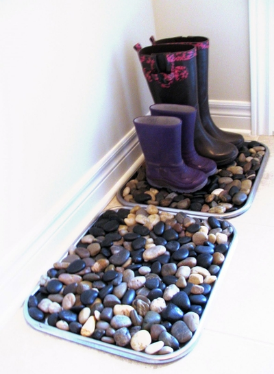 12.Put rocks in the bottom of boot trays to dry boots without the mess.