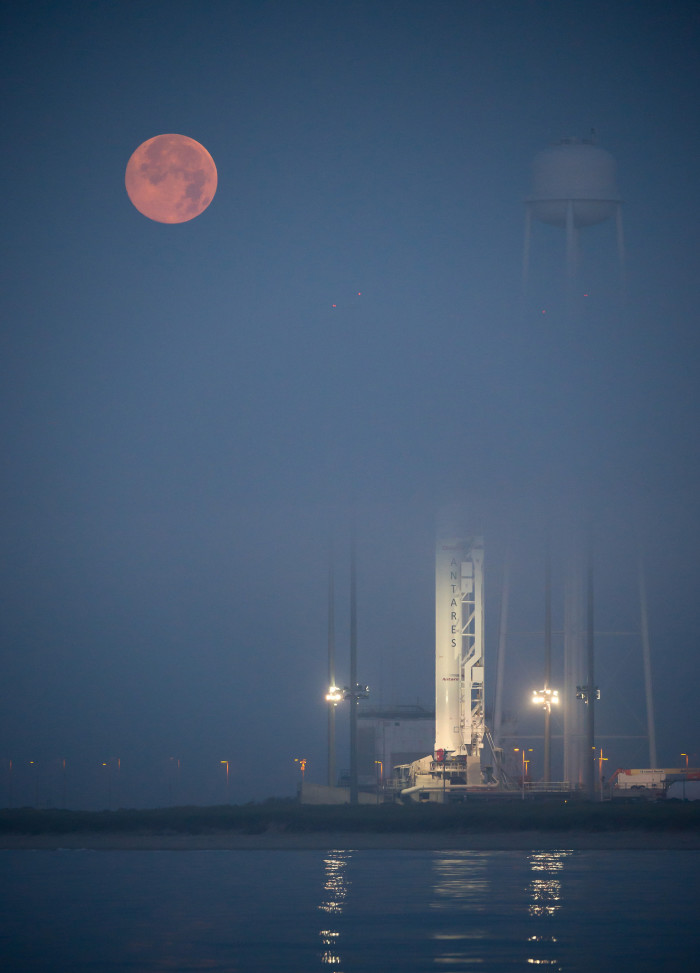 6. Between the eerie moon and the fog, the Orbital Sciences Corporation Antares rocket looks like it's in another time and dimension at NASA's Wallops Flight Facility.