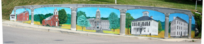 9. This painting of several historic buildings in Harrisville, including the Whitehall Motel, the General Thomas Harris Home, the Ritchie County Courthouse, St. Lukes U.M. Church and the Thomas Harris Museum, is painted on a retaining wall in Harrisville.