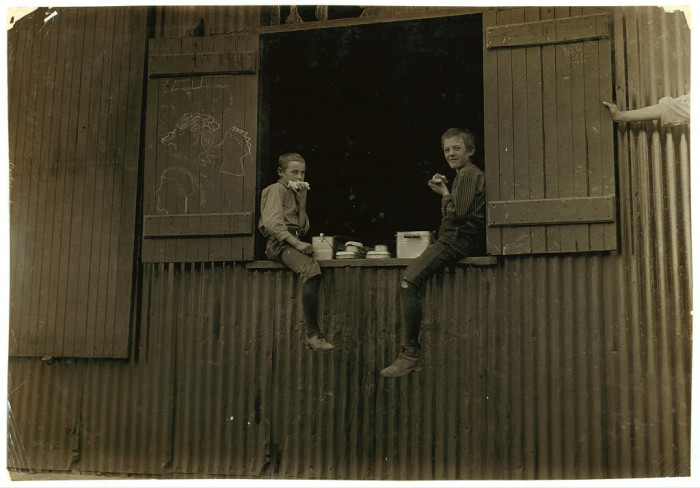 11. Child workers from the Economy Glass Works company in Morgantown have lunch in this photo taken in 1910.