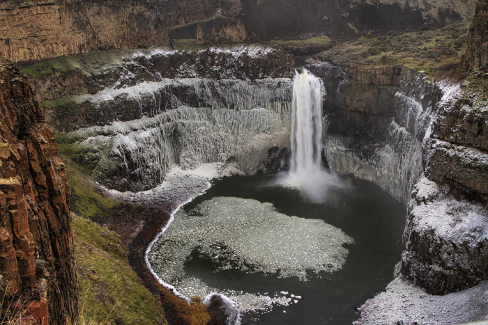 14. The sides of Palouse Falls covered in a powdery snow.